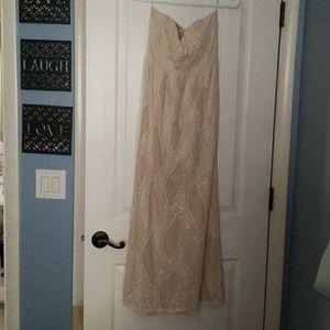 Pretty cream colored strapless maxi dress